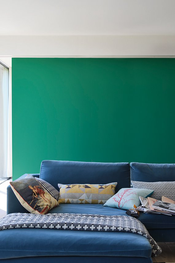 Living room wall painted with Farrow and Ball's 'Verdigris Green'