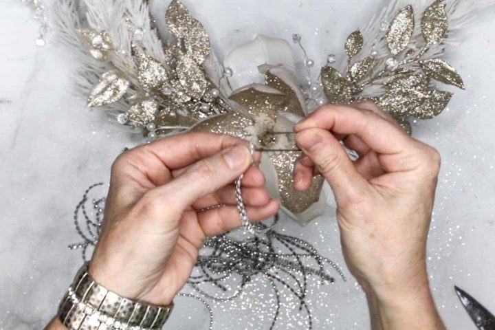 Diamond ribbon being added to a floral pin