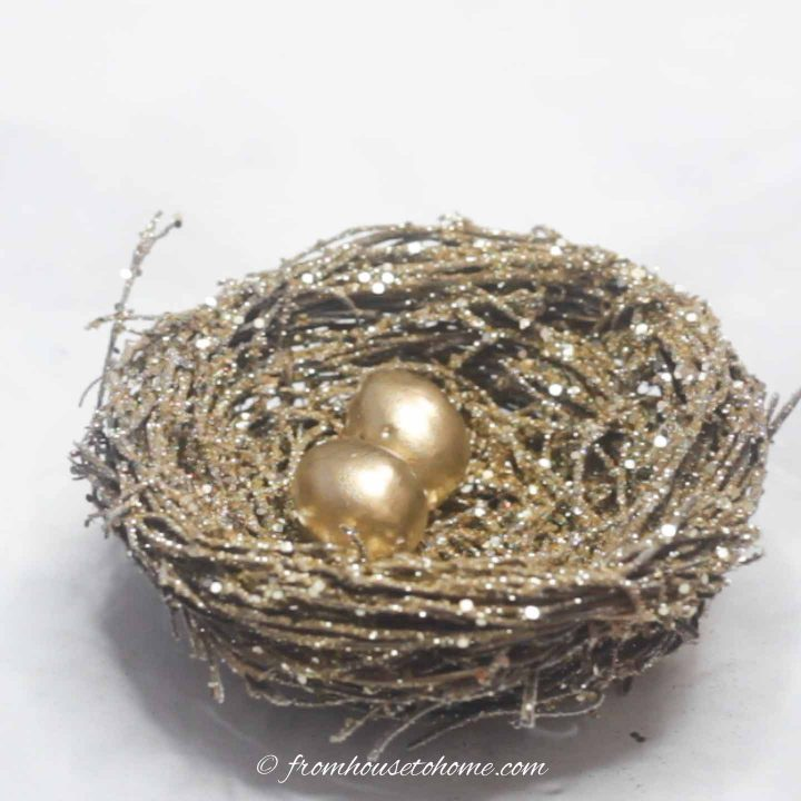 Twig nest with gold glitter and two mini eggs