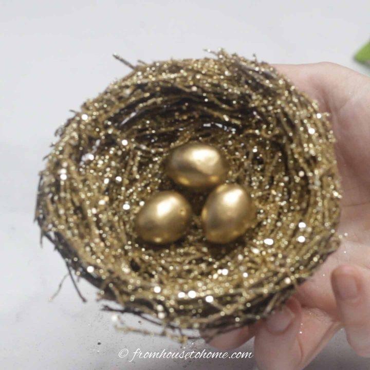 Glitter gold bird nest ornament with three mini eggs