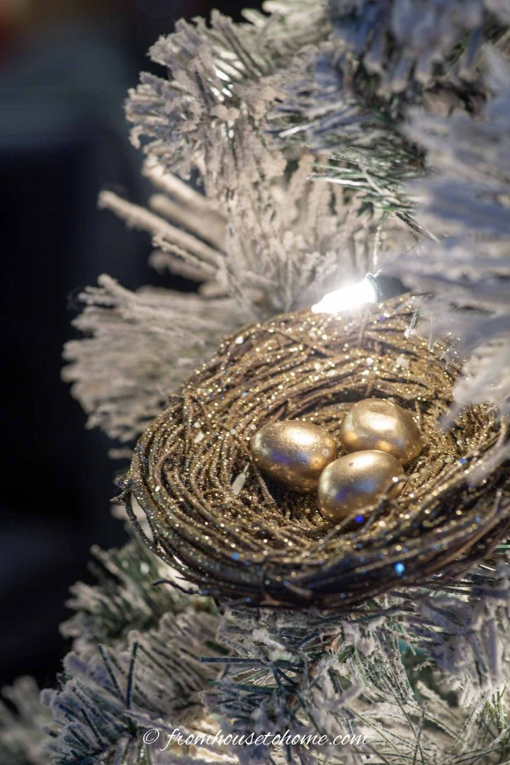 Gold bird nest ornament in a Christmas tree
