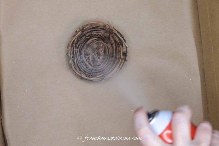 Twig nest sprayed with adhesive
