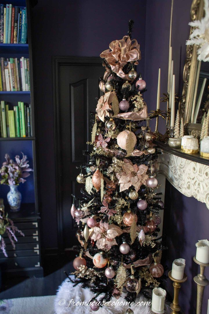 Black Christmas tree with pink and gold Christmas ornaments