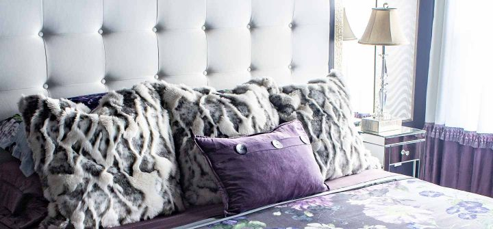 Purple and white bed with pillows