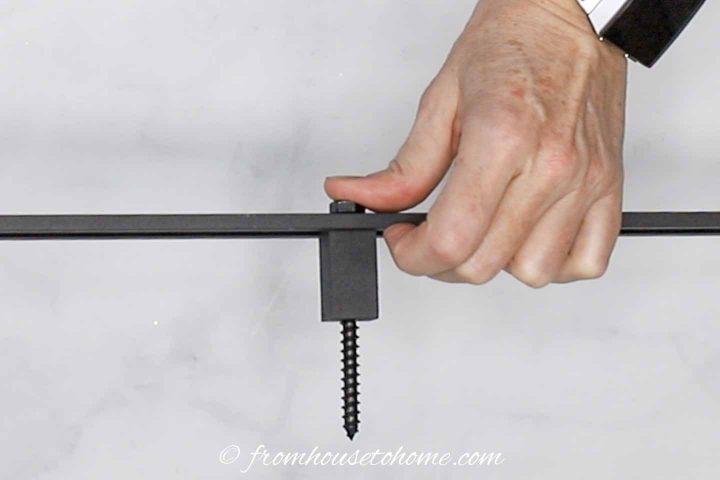 Installing the screw into the barn door track