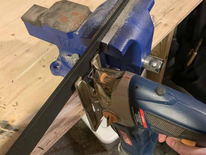 Jigsaw cutting the barn door track to size