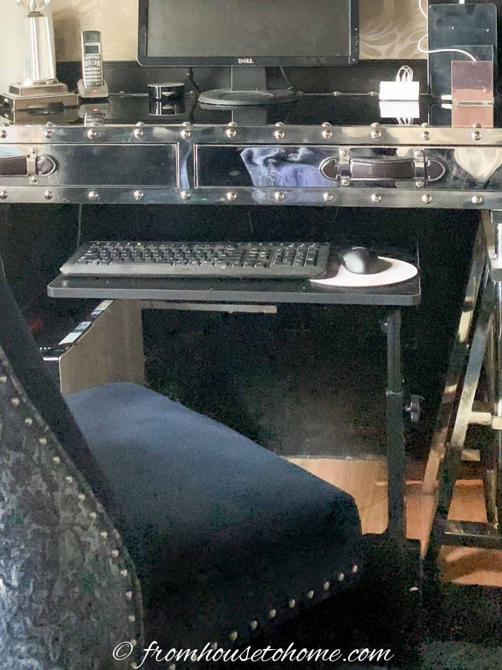 Laptop cart used as a keyboard tray under a desk