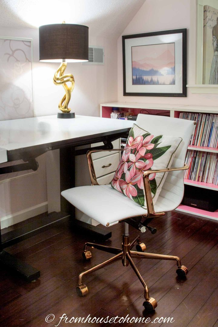 White leather desk chair with a black lamp