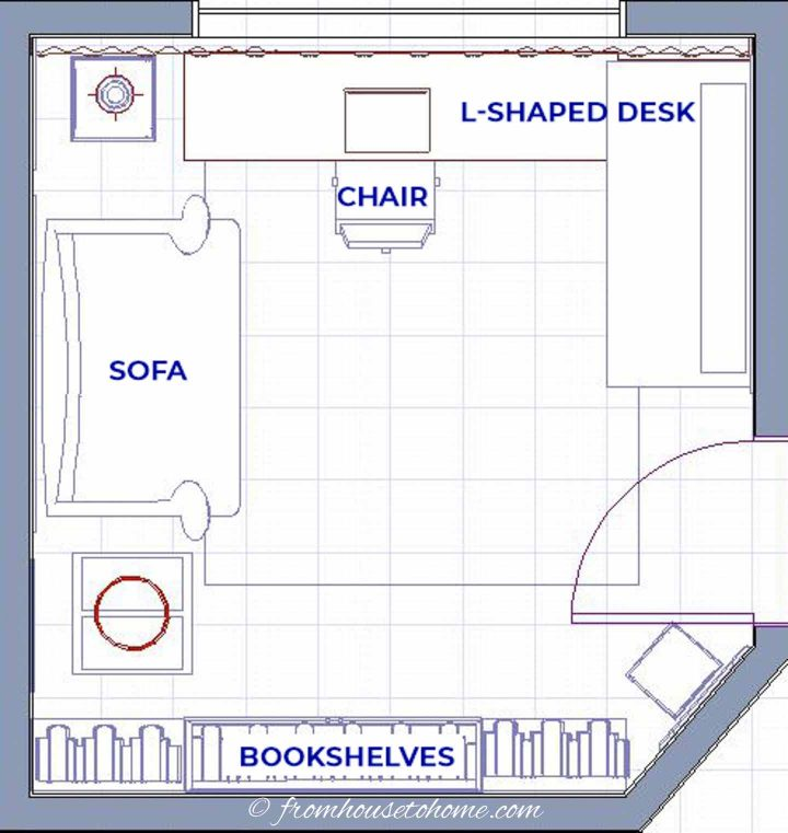 Small home office layout with an L-shaped desk in the corner and a couch