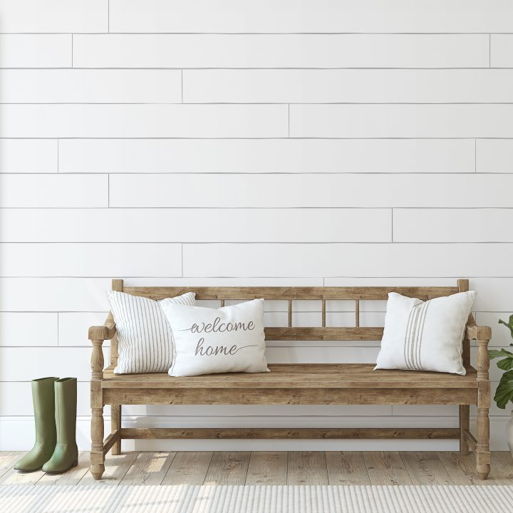 Farmhouse style entry way with bench and shiplap walls