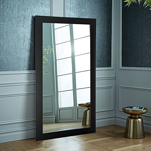 Oversized mirror leaning against the wall