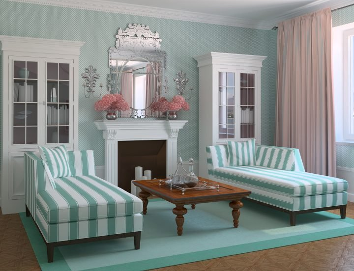 Symmetrical living room with two chaises on either side of a fireplace