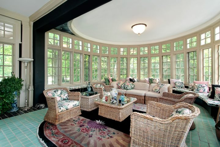 Round enclosed porch with wall to wall windows as the focal point