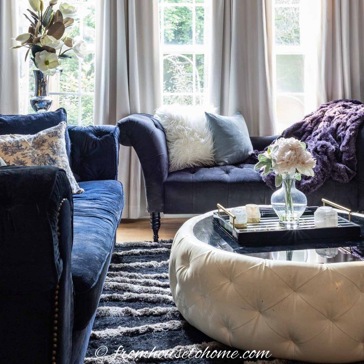 Living room with black and white coffee table and velvet sofas