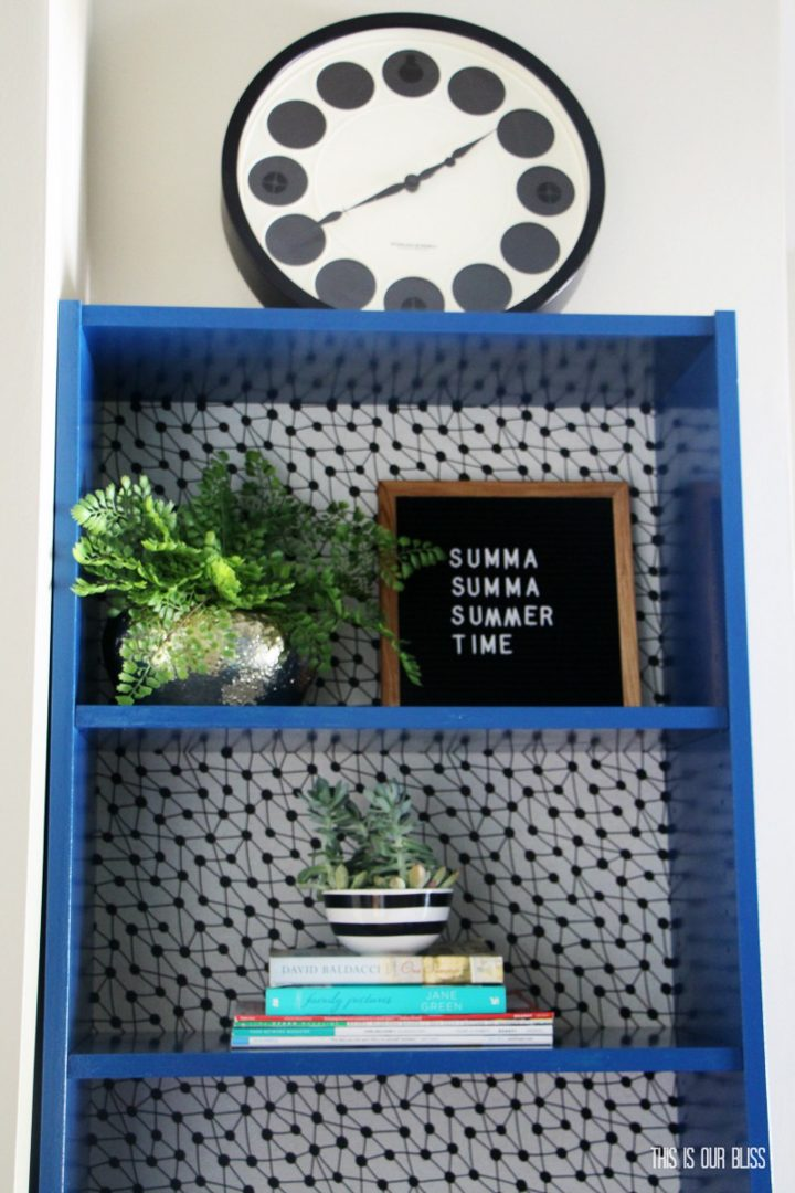 Upcycled bookshelf with wallpaper and blue paint by Rachael at thisisourbliss.com