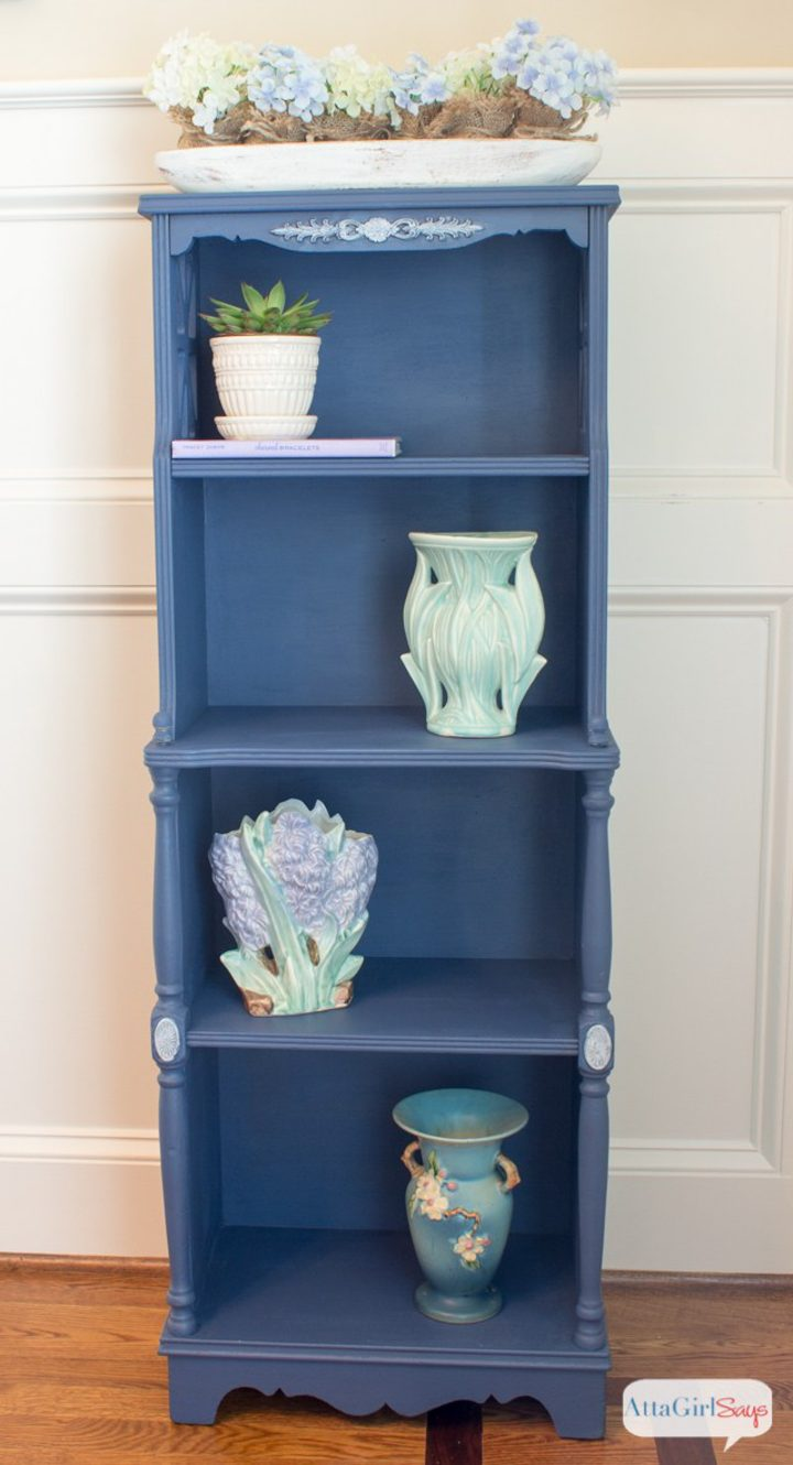 Blue painted bookshelf with pottery on it by Amy from attagirlsays.com