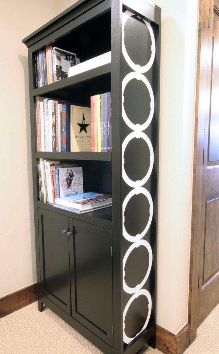 Black bookshelves with a graphic design on the side by Angela from blueistyleblog.com