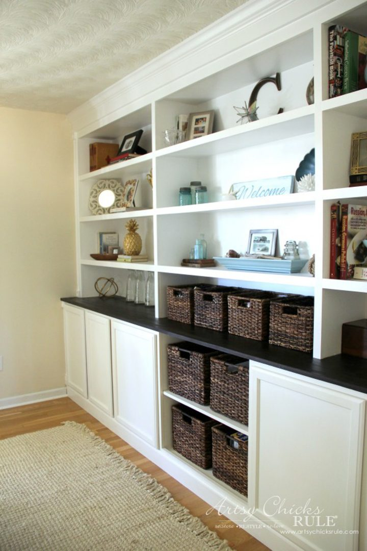 DIY built-in bookcases made from big box store cabinets by Nancy from artsychicksrule.com