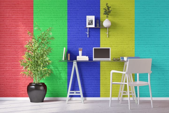 Office with wide, multi-colored stripes painted on a brick wall ©Robert Kneschke - stock.adobe.com