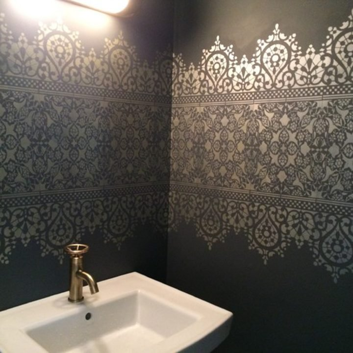 bathroom with lace pattern painted on the walls via houzz.com