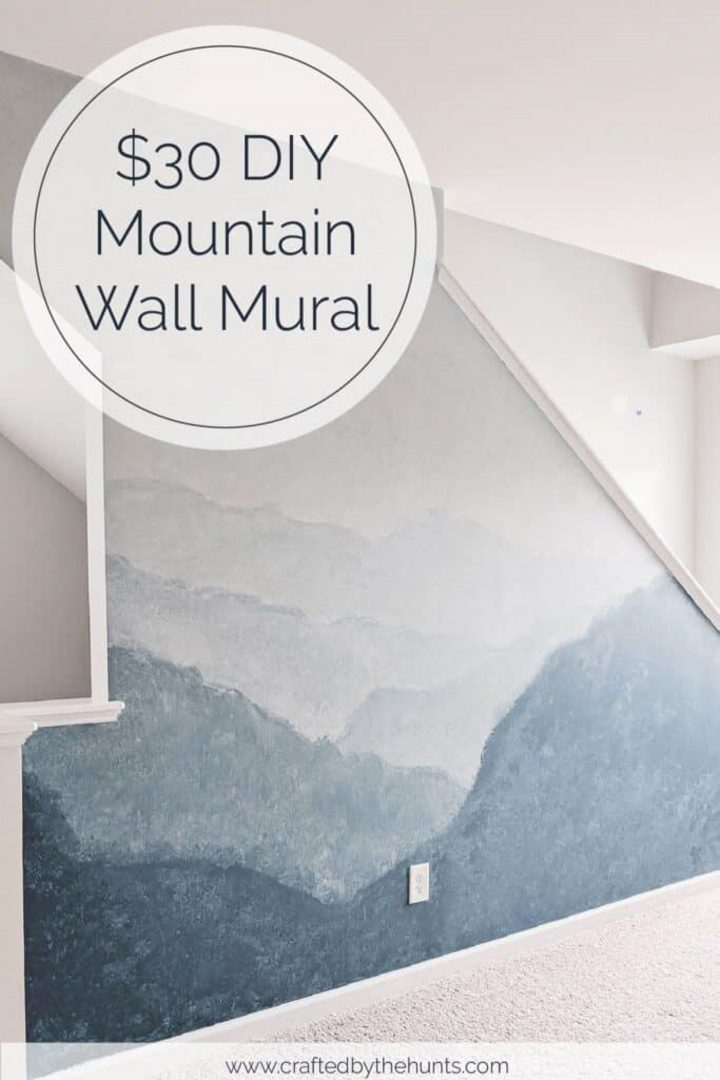 Wall with a painted mountain mural via craftedbythehunts.com