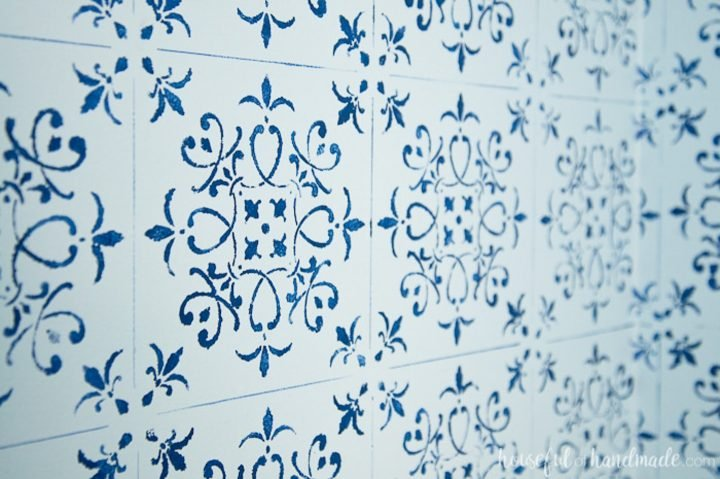Wall painted to look like blue and white tile via housefulofhandmade.com