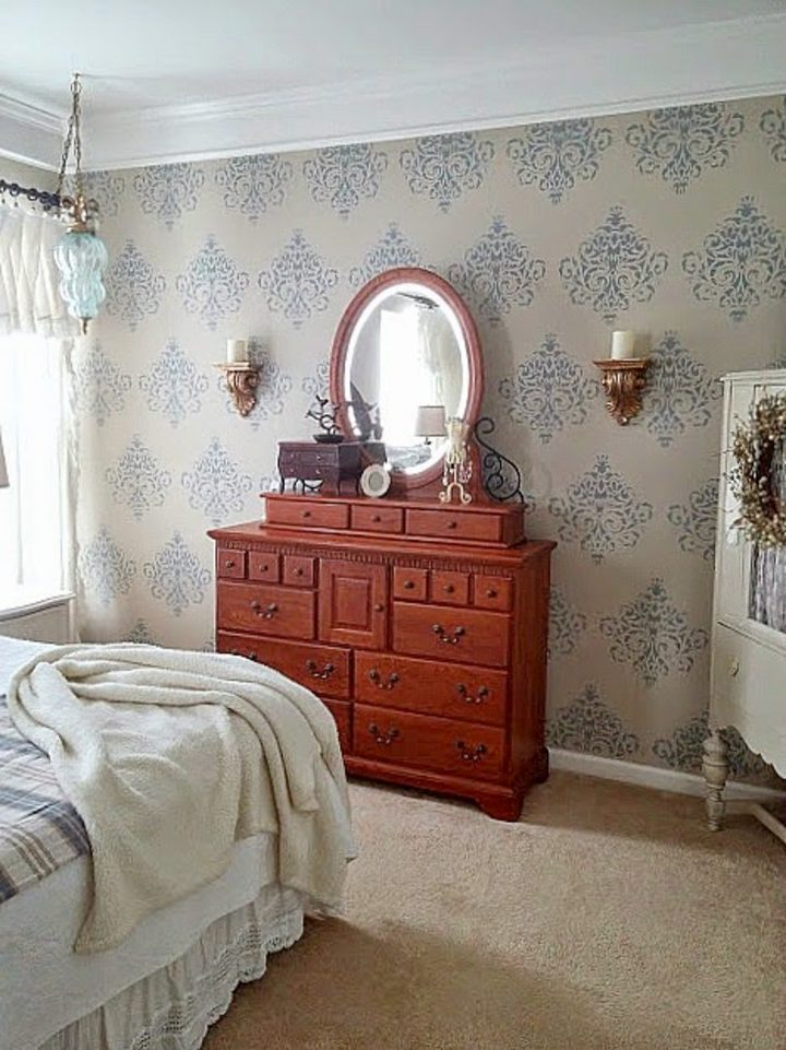 Bedroom wall painted with a damask stencil via diybeautify.com