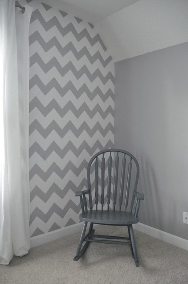 Wall painted with grey and white chevon stripes