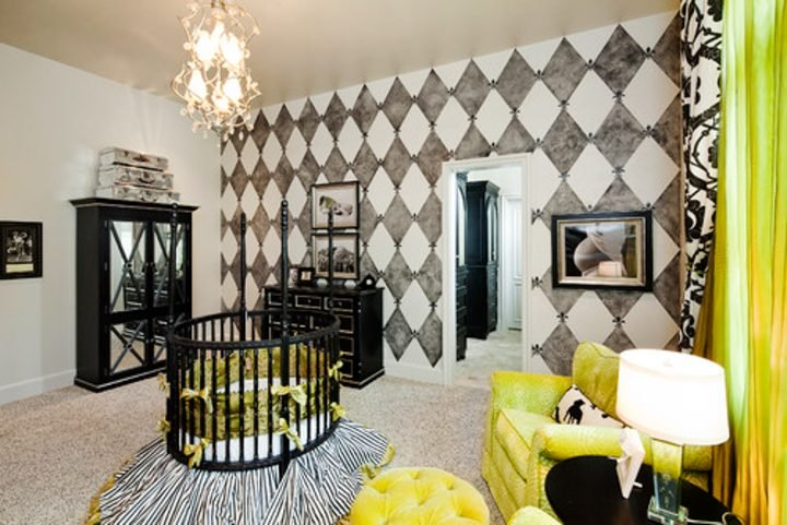 Nursery with wall painted in black and white diamond pattern