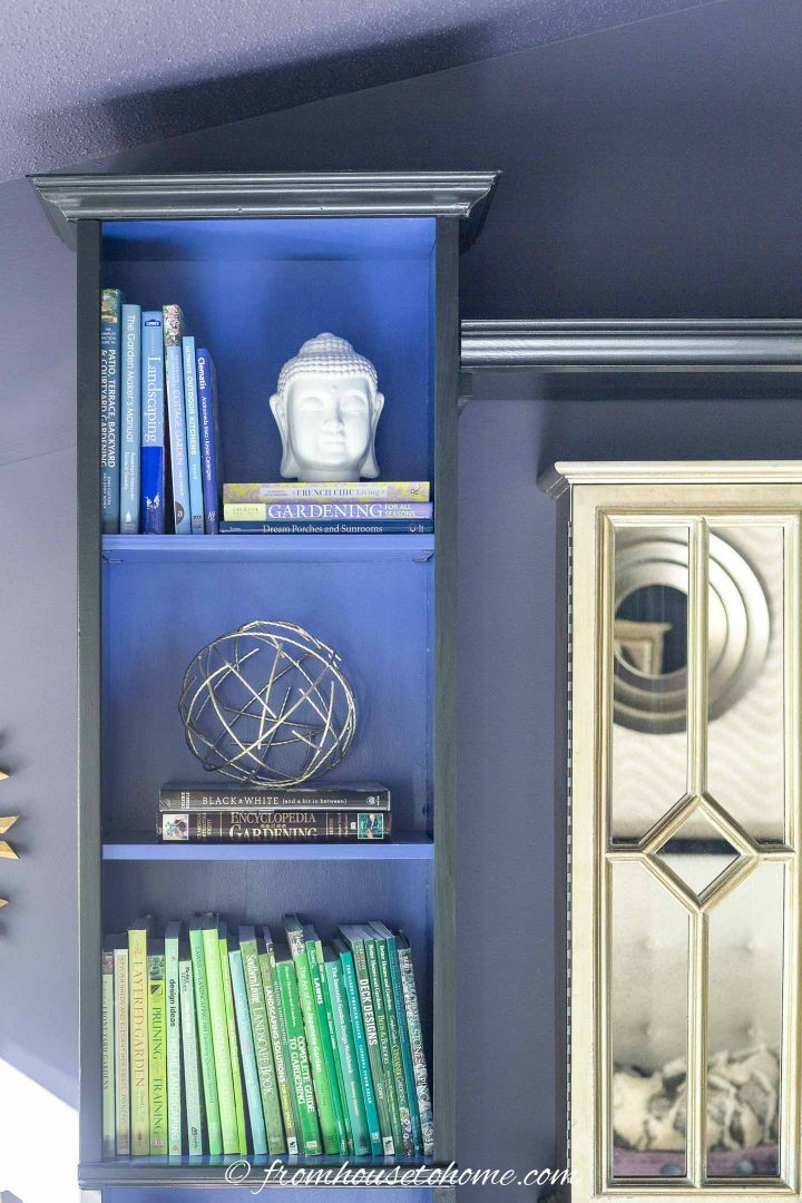 Bookcase with moldings added to the top of it