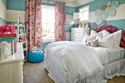 Bedroom with blue and white horizontal stripes painted on the walls via houzz.com