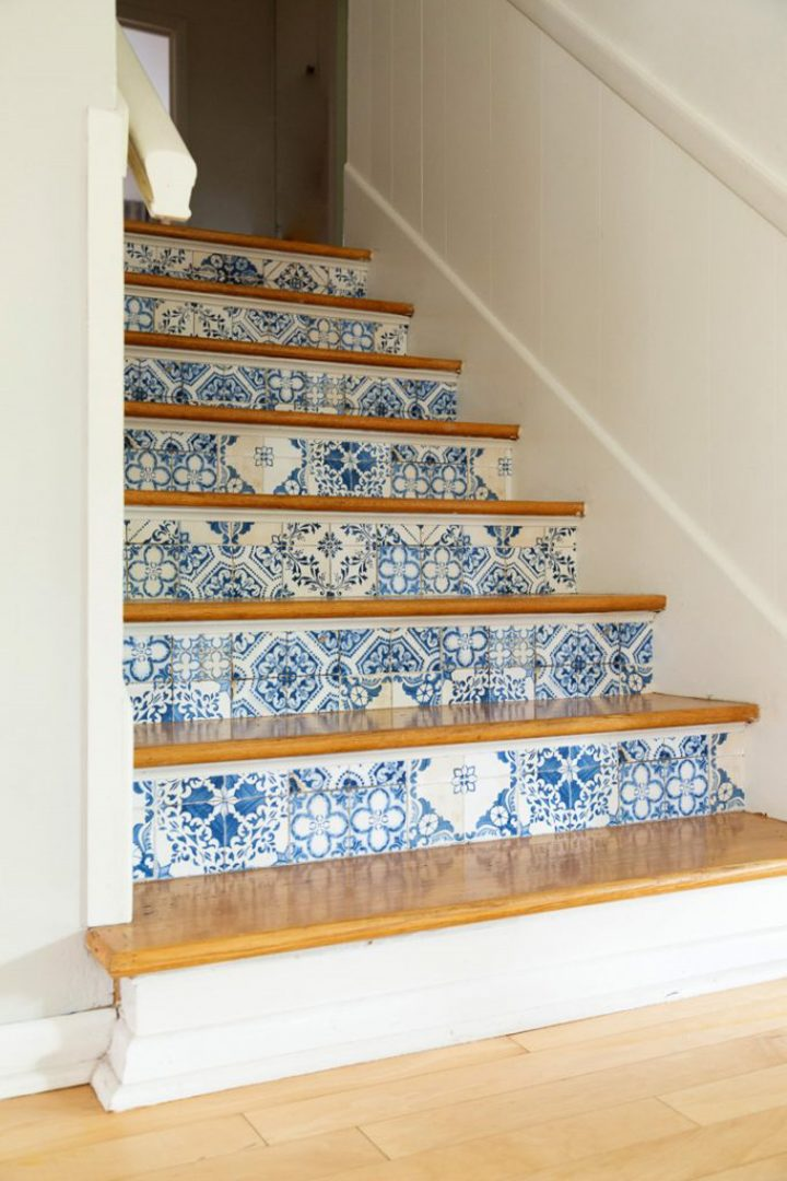 Stair risers wallpapered with a tile pattern via aliceandlois.com