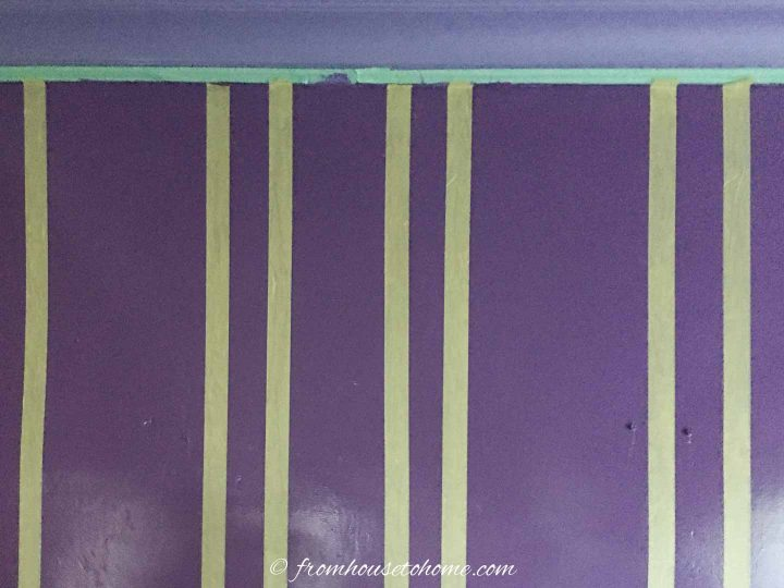 Vertical stripes outlined with painter's tape on the wall