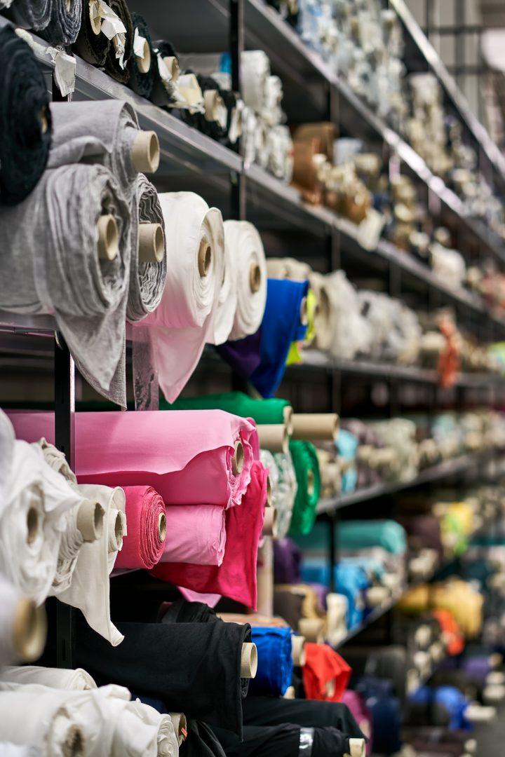 Rolls of fabric in a warehouse ©Andriy Bezuglov - stock.adobe.com