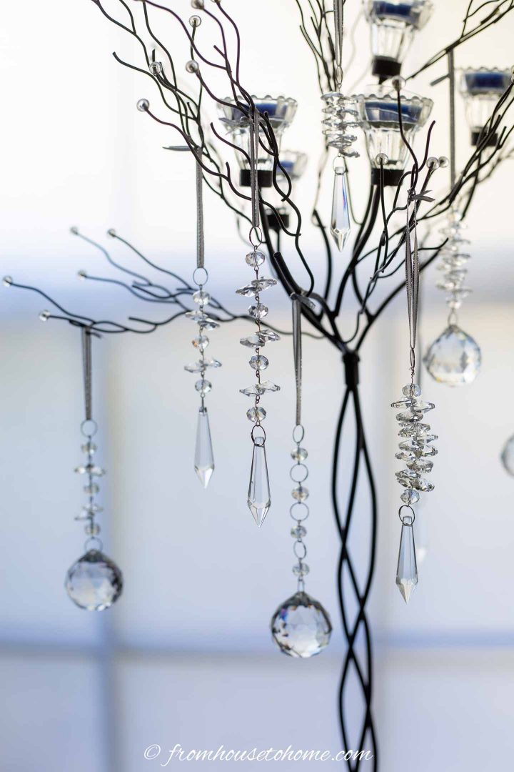 Crystal DIY Christmas ornaments hung from a candle tree