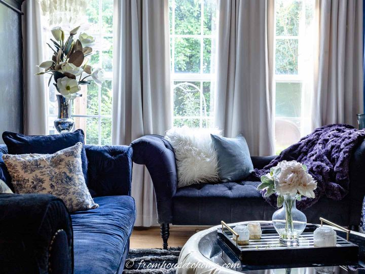 Cozy living room with velvet sofas and a chenille blanket