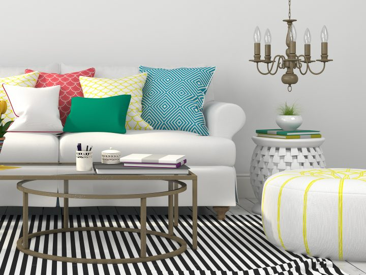 White living room sofa with a black and white striped area rug