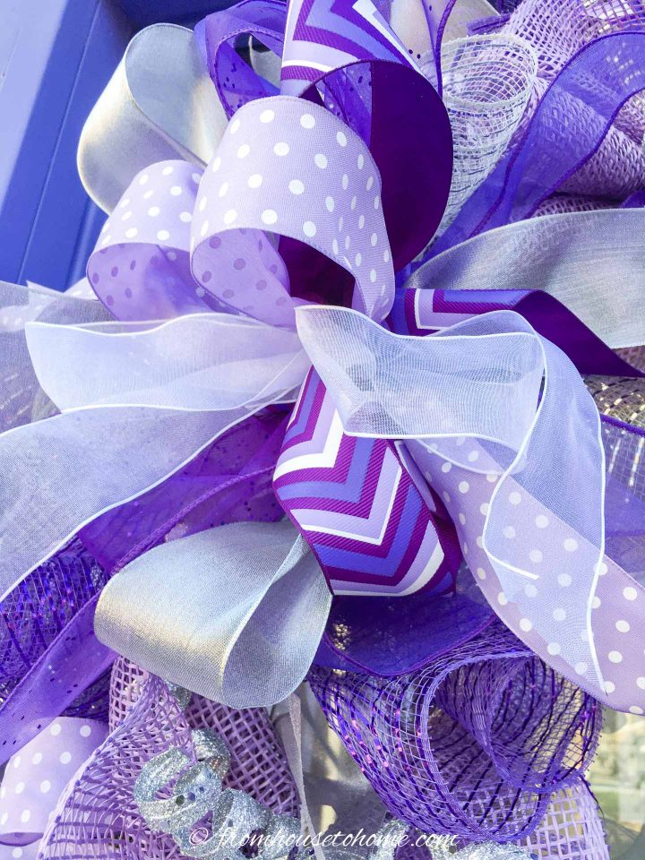 The large bow attached to the wreath
