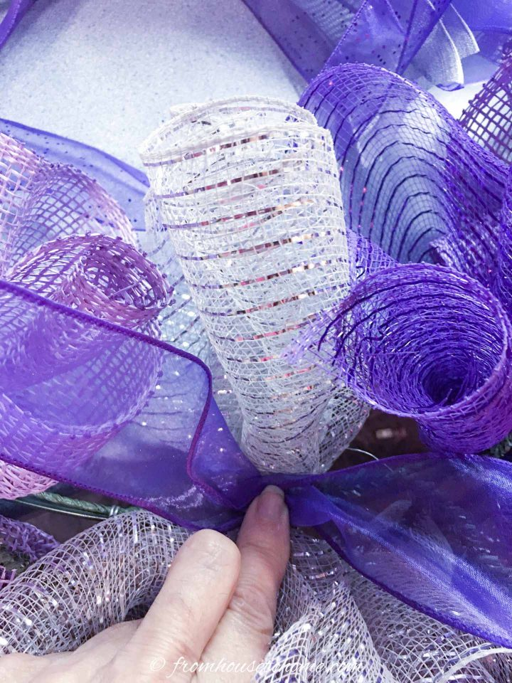 How to attach ribbon to the wire wreath form with the ties