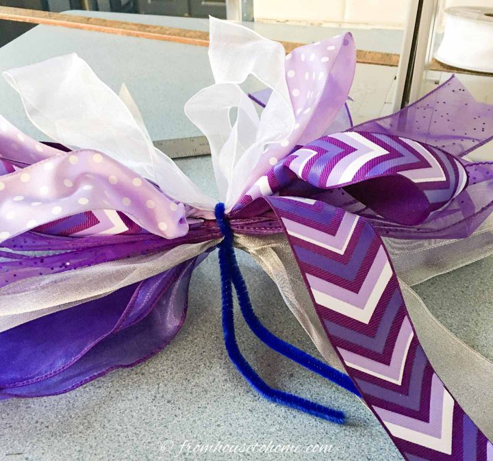 The ribbons tied with a pipe cleaner after being removed from the Bowdabra bow maker