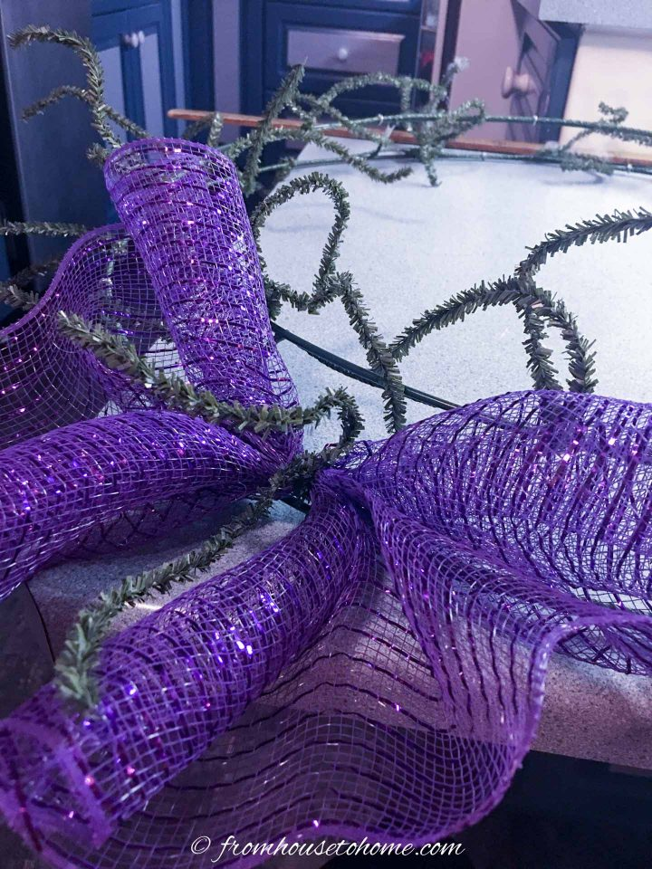 How to use ties on a wire wreath form to attach the deco mesh