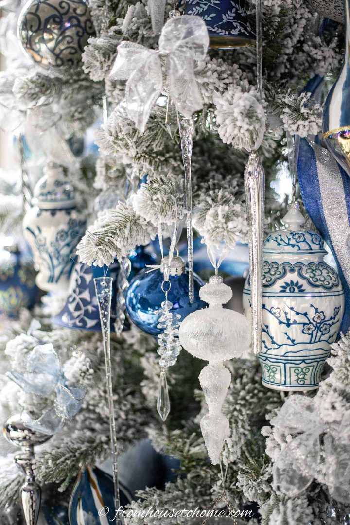 long icicle ornaments on a white, blue and silver flocked christmas tree
