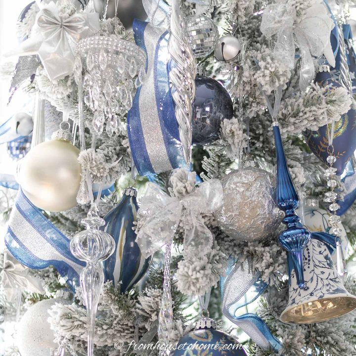 Large ball ornaments, ribbons and crystal ornaments on a flocked christmas tree