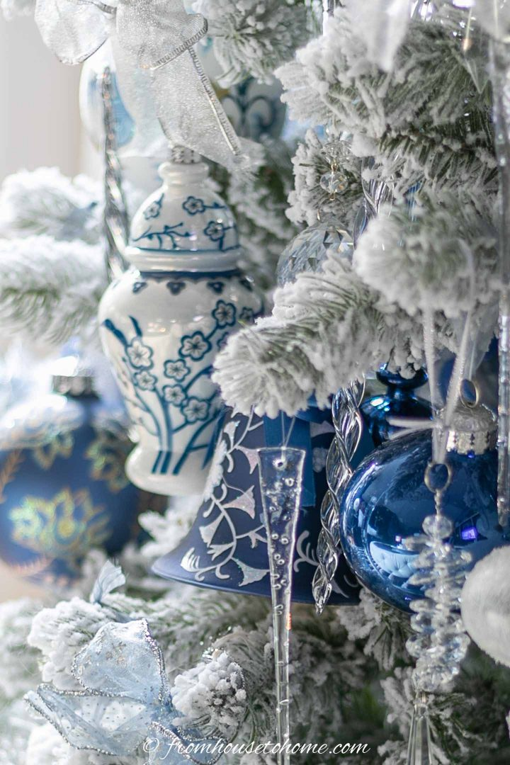 blue and white ginger jar ornament on a flocked christmas tree