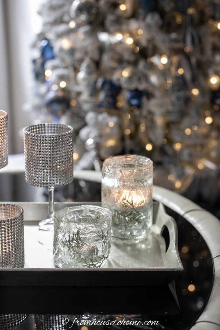 DIY faux ice candle holders in front of a christmas tree