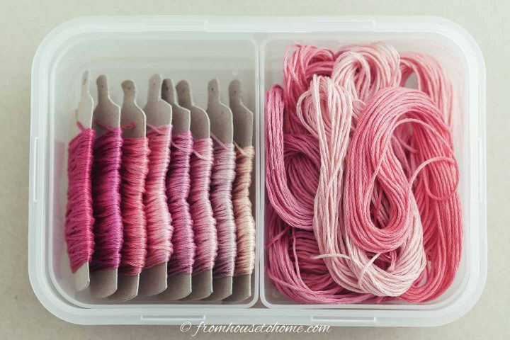 Pink wool in a plastic container