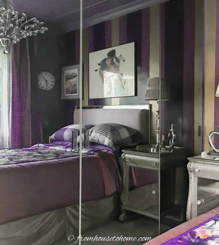 The purple and gold bedroom makeover with painted striped wall