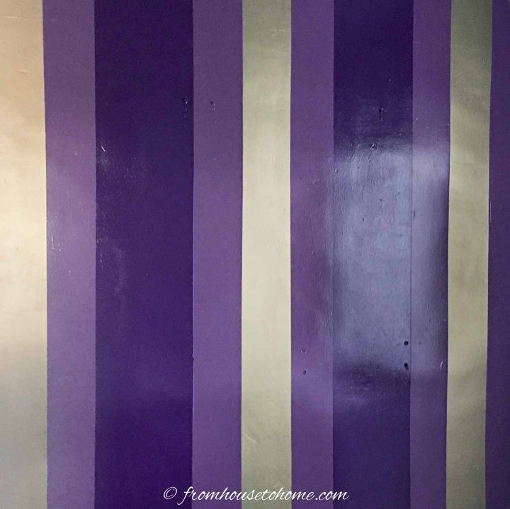 purple and gold striped wall
