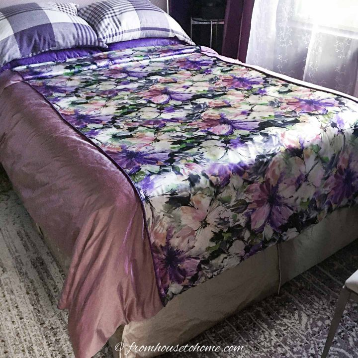 purple and gold bedroom makeover with a floral duvet cover