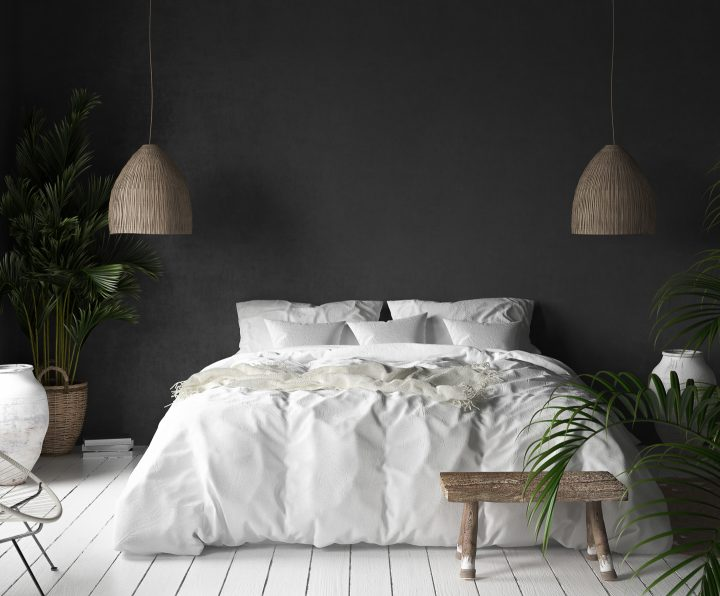 Black bedroom with rattan lamps, wood stool and plants ©jafara - shutterstock.com